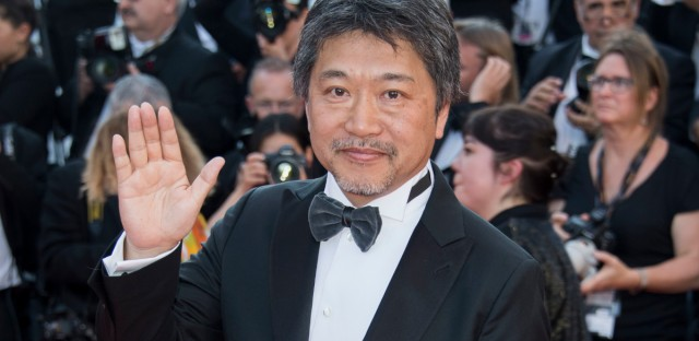 Director Hirokazu Koreeda poses upon arrival at the premiere of the film 'The Man Who Killed Don Quixote' and the closing ceremony of the 71st international film festival, Cannes, southern France, Saturday, May 19, 2018.