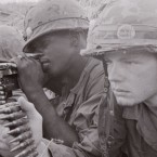 Ken Burns' 10-part, 18-hour series premiers Sunday. Above, an American Marine machine gun crew is poised for action.