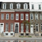 Rowhouses in Baltimore sit across the street from a church where Sen. Barbara Mikulski, D-Md., held a meeting last summer about, among other things, reducing ex-convict recidivism.