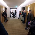 People stand in a hallway outside the 25th floor closed Russian consulate Monday, March 26, 2018, in Seattle. The United States and more than a dozen European nations kicked out Russian diplomats on Monday and the Trump administration ordered Russia's consulate in Seattle to close, as the West sought joint punishment for Moscow's alleged role in poisoning an ex-spy in Britain.