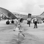 Passengers leave a Southeast Airlines plane in Key West, Fla., on July 1, 1968, upon returning from Havana after their airliner was forced to fly to Cuba. The pilot, a Cuban refugee living in Miami, was held on the island to stand trial as a deserter. In the foreground are Mrs. Charles Evans and her 19-month-old daughter, of Fort Worth, Tex.