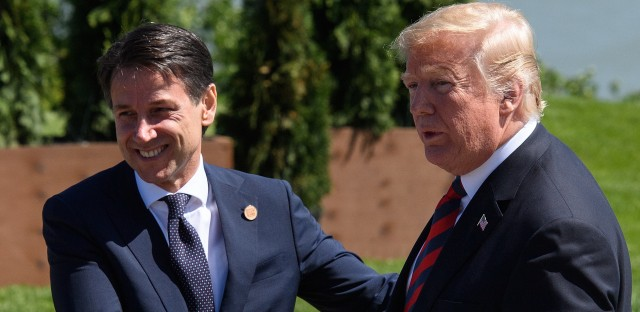 Italian Prime Minister Giuseppe Conte shakes hands with President Trump on June, 8 2018, in La Malbaie, Canada at the G-7 summit.
