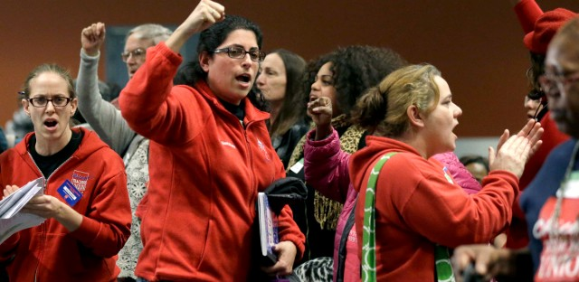 Members of the Chicago Teachers Union cheer during president Karen Lewis' speech at a March 23 news conference in Chicago.