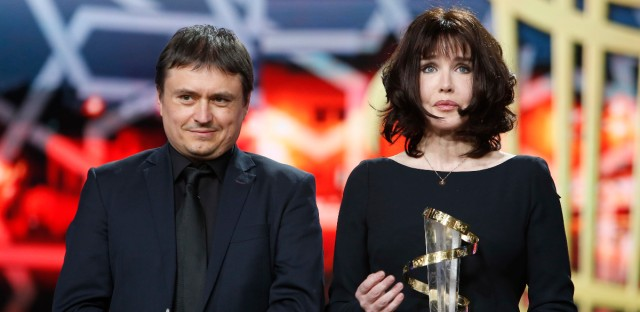 Director Cristian Mungiu, left, and French actress Isabelle Adjani pose for photographers during a tribute to her contribution to acting, during the 16th Marrakech International Film Festival in Marrakech, Morocco, Friday, Dec. 9, 2016.