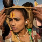 """In this Jan. 15, 2019, photo, an Indian hijra walks on the banks after taking a dip along with other members of the newly formed """"Kinnar akhara"""" monastic order on the auspicious Makar Sankranti day during the Kumbh Mela festival in Prayagraj, Uttar Pradesh state, India. Unlike other akharas, which are only open to Hindu men, Kinnar, founded in 2015, is open to all genders and religions. This is the first time the newly formed Kinnar Akhara, or monastic order, has set up camp at the massive temporary city in Prayagraj, led by transgender activist Laxmi Narayan Tripathi."""