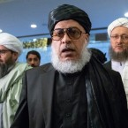 "Taliban political chief Sher Mohammad Abbas Stanikzai, center, walks in a hall as he attends the ""intra-Afghan"" talks in Moscow, Russia, Wednesday, Feb. 6, 2019. The U.S. has promised to withdraw half of its troops from Afghanistan by the end of April, a Taliban official said Wednesday, but the U.S. military said it has received no orders to begin packing up."