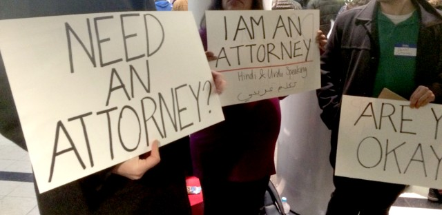 Attorneys announce their services at O'Hare International Airport.