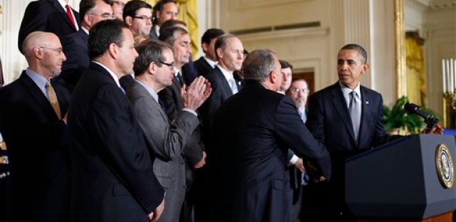 President Obama shakes hands with Tim Bryan, center, chairman and CEO of Galax.e Solutions, during a forum on 'Insourcing American Jobs' in January.