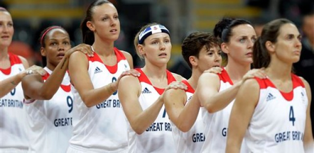 Great Britain women's basketball team members join together for the national anthems before a preliminary women's basketball game against Canada at the 2012 Summer Olympics, Monday, July 30, 2012, in London.