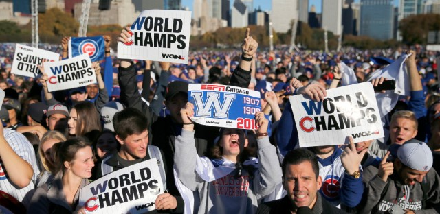 Chicago Cubs fans celebrate before a rally in Grant Park honoring the World Series baseball champions Friday, Nov. 4, 2016, in Chicago.  Charles Rex Arbogast/Associated Press