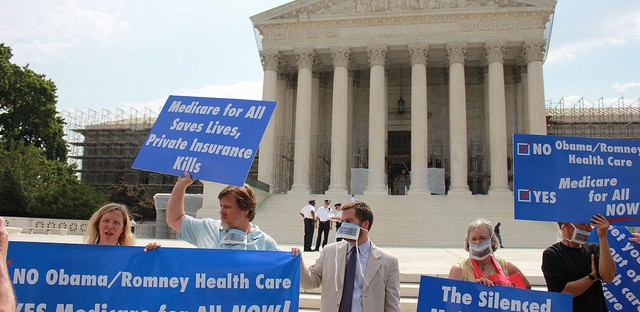 Protesters outside the Supreme Court as the ACA ruling came down Thursday morning.