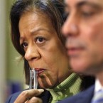 In this Oct. 12, 2012 file photo, former CPS CEO Barbara Byrd-Bennett looks over Mayor Rahm Emanuel's shoulder at a news conference in Chicago. The former CEO has been indicted on corruption charges following a federal investigation into a $20 million no-bid contract. Bennett was indicted Thursday, Oct. 8, 2015, nearly four months after she resigned amid an investigation into the contract between the district and SUPES Academy, a training academy where she once worked as a consultant.