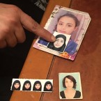 Tunisian Olfa Hamrouni points at pictures of her daughters Rahma (above) and Ghofran. The teenage girls were exploited by extremist recruits and left their homeland to join ISIS in neighboring Libya.
