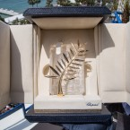 A person holds up a box containing the Palme d'Or award, which will be presented on Sunday, at the 68th international film festival, Cannes, southern France, Saturday, May 23, 2015.