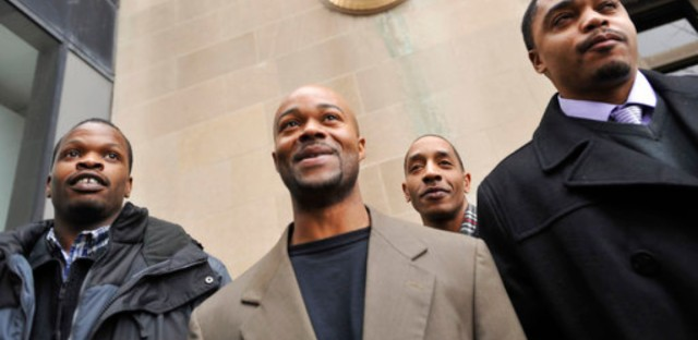 """FILE - In this Jan. 17, 2012 file photo, Harold Richardson, left, Vincent Thames, second from left, Terrill Swift, and Michael Saunders, right, pose for a photo after a hearing in Chicago for the four men known as """"the Englewood Four,"""" whose 1994 rape and murder convictions were overturned in November 2011. New DNA evidence linked another person to the crime."""