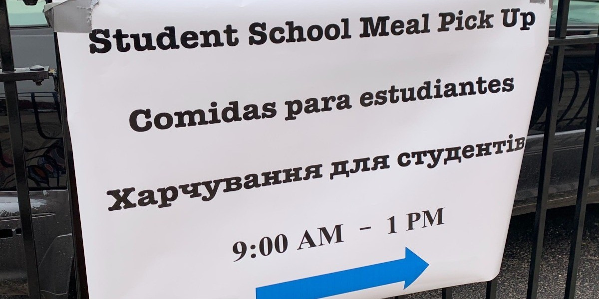 A sign pointing to free meal pick up at Frederic Chopin Elementary School