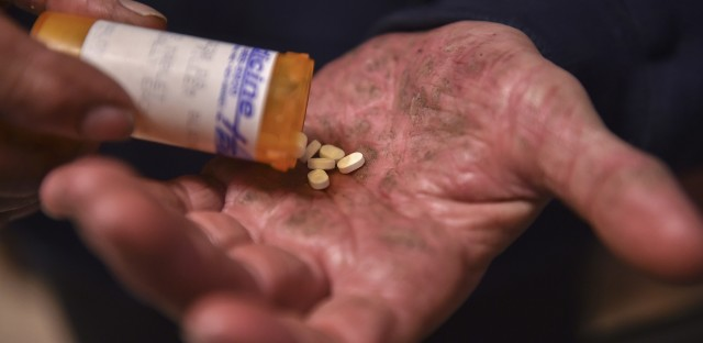A man in Mount Airy, Md., shakes Suboxone pills from a bottle in late March.