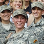 Army 1st Lt. Shaye Haver (center) and Capt. Kristen Griest (right) pose for photos with other female West Point alumni after an Army Ranger school graduation ceremony at Fort Benning, Ga., in 2015. They were the first two women to graduate from U.S. Army Ranger school.