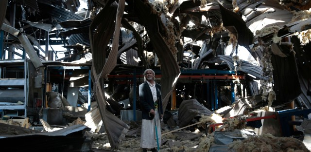 An elderly man stands among the rubble of the Alsonidar Group's water pump and pipe factory after it was hit by Saudi-led airstrikes in Sanaa, Yemen, Thursday, Sept. 22, 2016. The Saudi-led coalition has been carrying out airstrikes against Yemen's Houthi rebels and their allies since March 2015.