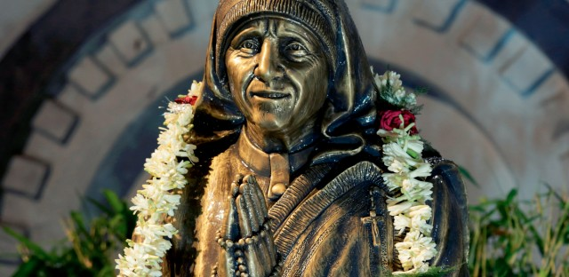 The garlanded bronze statue of Mother Teresa after it was unveiled by Mamata Banerjee, Chief Minister of West Bengal state at Archbishop's House in Kolkata, India, Friday, Aug. 26, 2016. Nobel Peace Prize winner Mother Teresa, born on this day at Skopje, Macedonia, Slovenia in 1910, was a Catholic nun who spent 45-years serving the poor, the sick, the orphaned, and the dying. Mother Teresa will be made a saint on Sept. 4 by Pope Francis. (AP Photo/Bikas Das)