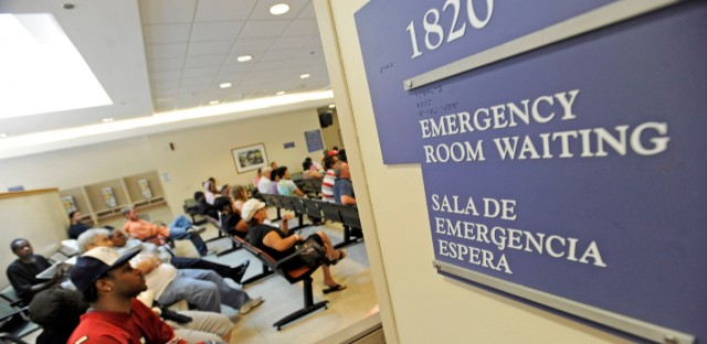 Patients wait in the emergency room at John H. Stroger Jr. Hospital on July 30, 2009. Stroger on the Near West Side and Provident Hospital on the South Side provided nearly half of all the free care in Cook County in 2016, according to a WBEZ analysis.