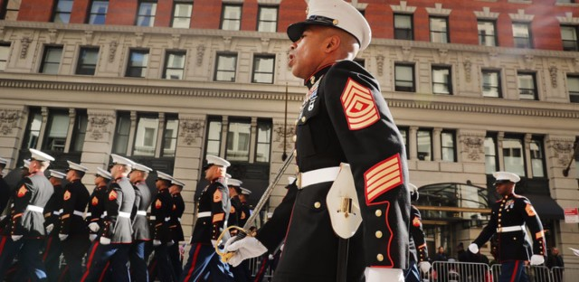 A Pentagon investigation is under way into the posting of hundreds, and perhaps thousands, of nude photos of female Marines. Here, members of the service march in the Veterans Day Parade in New York City last November.