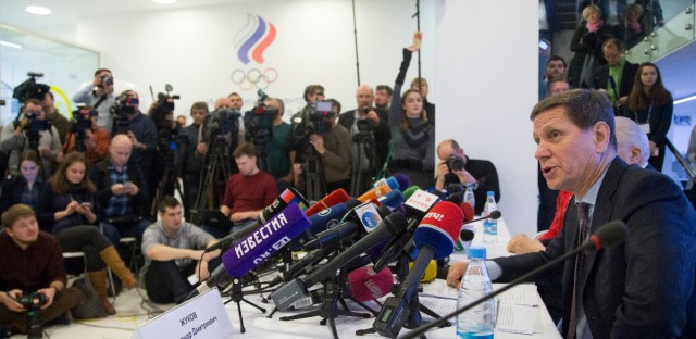 Russian Olympic Committee President Alexander Zhukov, right, speaks to the media after an Russian Olympic committee meeting in Moscow, Russia, Tuesday, Dec. 12, 2017. The Russian Olympic Committee formally gave its blessing Tuesday for the country's athletes to compete under a neutral flag at the upcoming Pyeongchang Games.