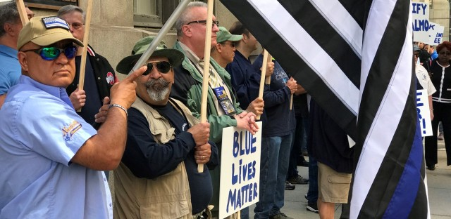 Dozens of Fraternal Order of Police members picket outside City Hall in 2018. Union balloting that ends on Thursday could lead to a run-off between two presidential candidates vowing a more combative approach.