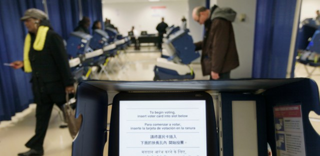 Voters cast their ballots during early voting at the Board of Elections building in Chicago.