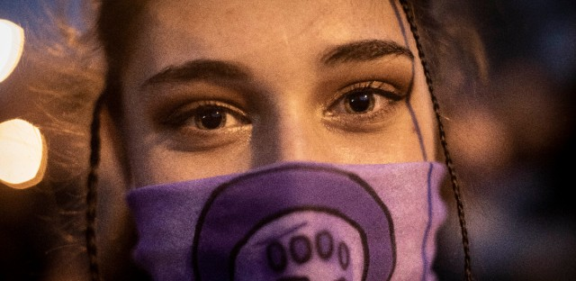 A woman attends a rally to mark International Women's Day in Madrid, Friday, March 8, 2019. Marches and protests are held Friday across the globe to mark International Women's Day under the slogan #BalanceforBetter, with calls for a more gender-balanced world. The day, sponsored by the United Nations since 1975, celebrates women's achievements and aims to further their rights. Thousands of women walked off the job in Spain, joining millions more around the world demanding equality amid a persistent salary gap, violence and widespread inequality.