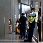 A Chicago Police officer stands guard at O'Hare International Airport in Chicago on July 1, 2016.