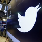 The Twitter symbol appears above a trading post on the floor of the New York Stock Exchange.