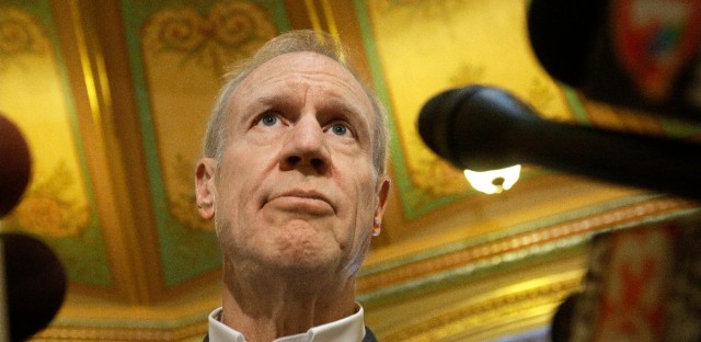 Illinois Gov. Bruce Rauner speaks to reporters in the rotunda at the Illinois State Capitol Monday, Sept. 26, 2016, in Springfield, Ill.