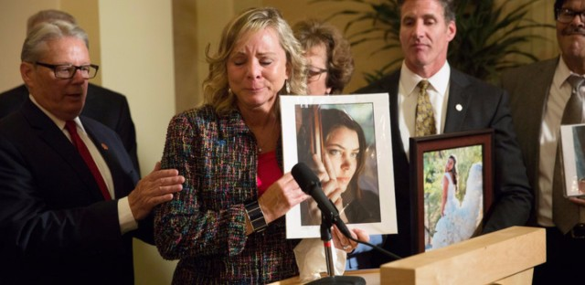 Debbie Ziegler holds a photo of her late daughter, Brittany Maynard, while speaking to the media in September after the passage of California's End Of Life Option Act. Maynard was an advocate for the law.