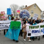 Residents of East Chicago, Ind., and supporters rally near a public-housing complex Wednesday, April 19, 2017, where roughly 1,000 people were ordered evacuated because of lead contamination.
