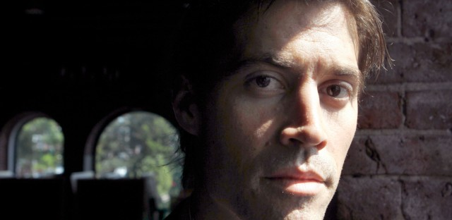 In this May 27, 2011 file photo, American journalist James Foley, of Rochester, N.H., poses for a photo in Boston. Jake Zelinski has been named Wednesday, Aug. 19, 2015, the first recipient of a scholarship named for journalist Foley, who was kidnapped in Syria and later beheaded by Islamic State militants.