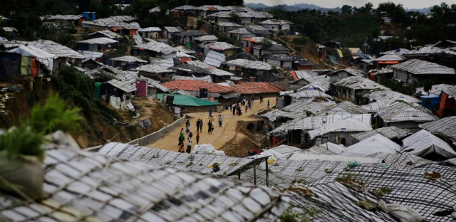 Rohingya refugees walk at Balukhali Refugee Camp in Bangladesh, Monday, Aug. 27, 2018. Investigators working for the U.N.'s top human rights body said Monday that Myanmar military leaders should be prosecuted for genocide against Rohingya Muslims, taking the unusual step of identifying six by name among those behind deadly, systematic crimes against the ethnic minority.