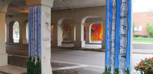 Murals painted on underpasses throughout Rogers Park, including this one on the Touhy Avenue CTA viaduct, is one of the projects funded through participatory budgeting in Chicago's 49th ward.