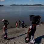 Indian women return after washing clothes in the river Brahmaputra in Gauhati, India on Monday, Dec.11, 2017.