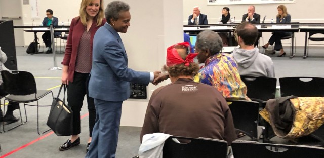 Chicago Mayor Lori Lightfoot greets attendees at a meeting of the Chicago Police Board on Thursday. Lightfoot used to run the police board before stepping down and running for mayor.