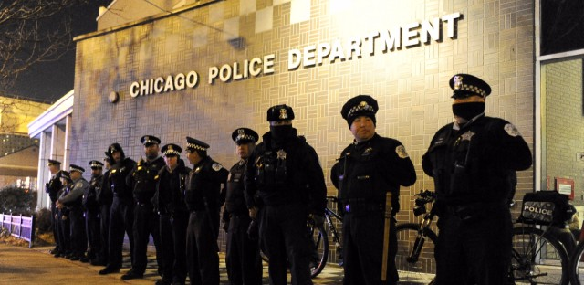 Chicago police officers line up outside the Central District headquarters at 17th and State streets Nov. 24, 2015 in Chicago during a protest for 17-year-old Laquan McDonald, who was fatally shot in October 2014. Chicago Police Officer Jason Van Dyke was charged with first-degree murder in the killing.