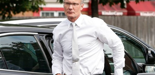 In this Tuesday, Sept. 8, 2015 file photo, dentist Walter Palmer arrives back at his office following a lunch break in Bloomington, Minn. A Zimbabwe Cabinet minister said Monday, Oct. 12, 2015, that the country is no longer pressing for Palmer's extradition following the hunting and killing a well-known lion called Cecil.