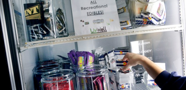 A budtender prepares an edible sale for a customer at LivWell Broadway in Denver.