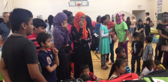 RefugeeOne relies on volunteers to work with refugee families and to donate supplies, such as these backpacks distributed at a back-to-school fair for refugee youth in 2014. Since the November election, the group has seen a surge in interest from would-be volunteers.