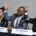 Chicago Police Board members from left, Melissa Ballate, Ghian Foreman, and board president Lori Lightfoot, vote to approve the three final contenders to become the city's police superintendent, Thursday, March 17, 2016, in Chicago. The candidates include two African American men and a retired Washington state police chief who would become the first woman to lead the force.