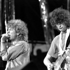 """n this July 13, 1985 file photo, singer Robert Plant, left, and guitarist Jimmy Page of the British rock band Led Zeppelin perform at the Live Aid concert at Philadelphia's J.F.K. Stadium. Generations of aspiring guitarists have tried to copy the riff from Led Zeppelin's """"Stairway to Heaven."""" Starting Tuesday, June 14, 2016, a Los Angeles court will try to decide whether the members of Led Zeppelin themselves ripped off that riff. Page and Plant are named as defendants in the lawsuit brought by the trustee of late guitarist Randy Wolfe from the band Spirit."""