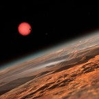 This artist's rendering shows what the view might look like from one of the three planets orbiting an ultracool, reddish dwarf star just 40 light-years from Earth.