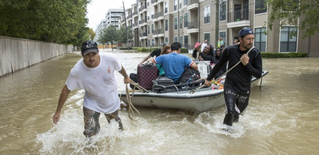 Residents are evacuated from an apartment complex near the Energy Corridor of west Houston on Wednesday. The confirmed death toll from Harvey is at least 10, across four Texas counties.