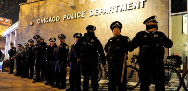 Chicago police officers line up outside the District 1 central headquarters on Nov. 23, 2015.