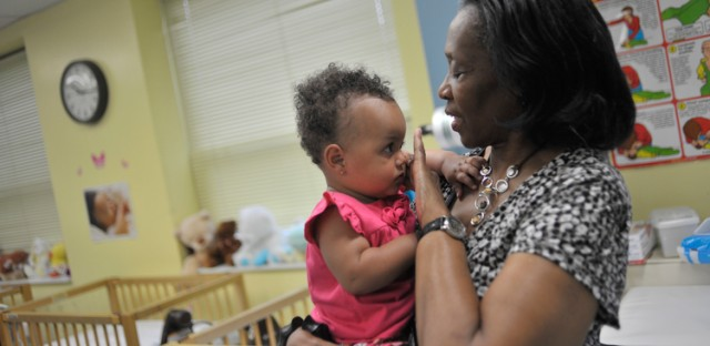 Clinical Director Florence Wright holds a child at The Women's Treatment Center. Wright oversees day-to-day operations of the center's daycare, crisis nursery and preschool classroom among other things.